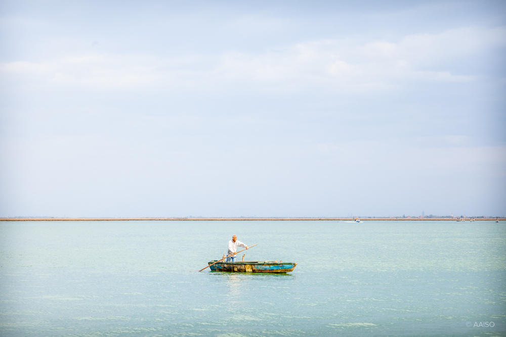 Fisherman outside Burano, one of the islands in the Venetian Lag