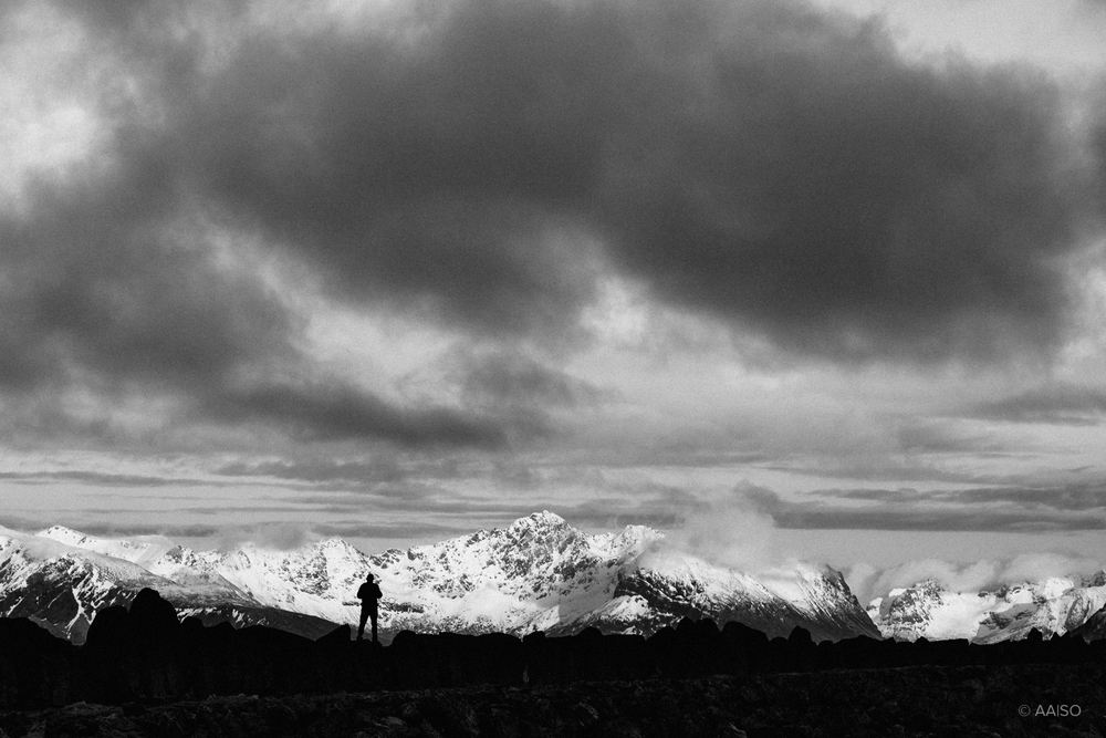 Silhouette against snowy mountains
