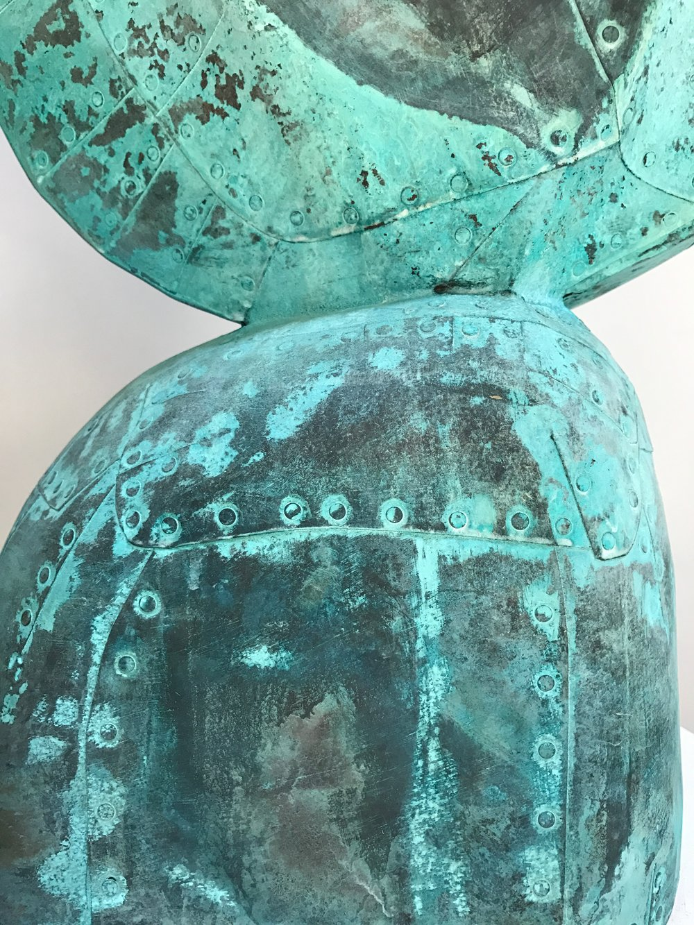 "Hybrid detail,  Patinated hammered copper over carved wood, 43"" x 32"" x 8"""