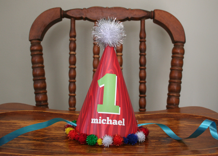 I even got my hot glue gun out for this party. (I had been dying to do so for way to long) Here is a handmade party hat that Michael was not so thrilled to wear. At least it looked cute on his highchair.