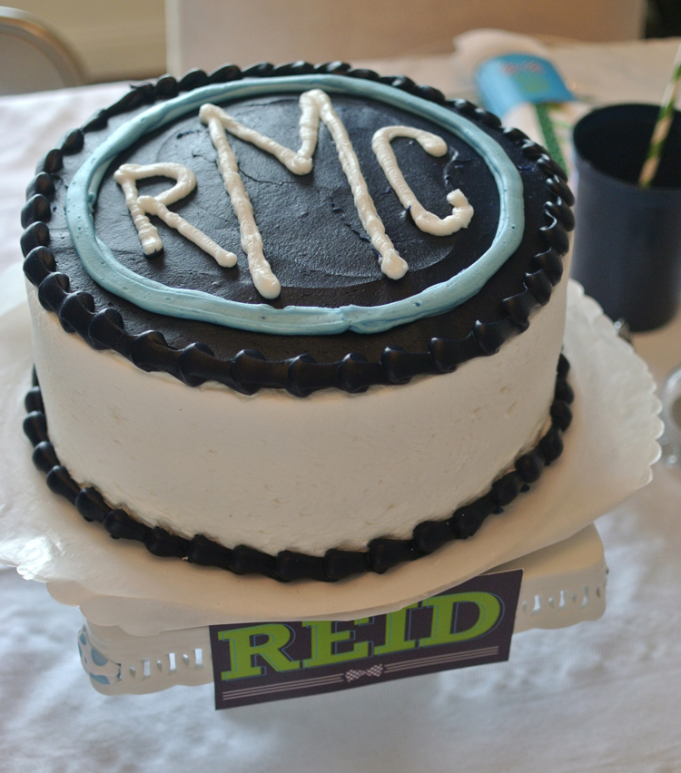 The cutest monogrammed cake was complete with a personalized cake banner.