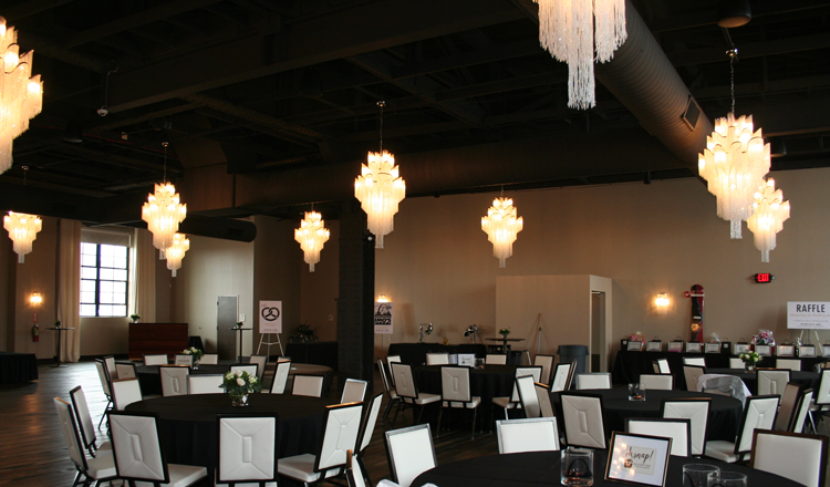 The main room where the band was located along with the silent auction, raffle items and food stations.