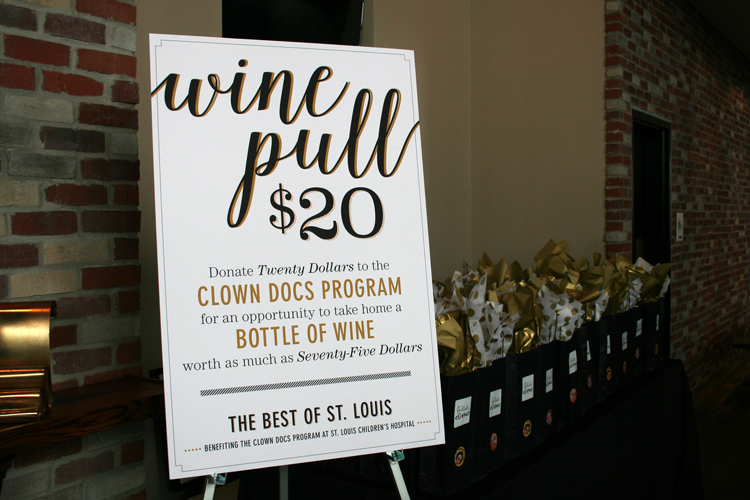 The wine pull was really popular! I loved the sign and the whole concept. Plus, I went home with a really nice bottle of wine!