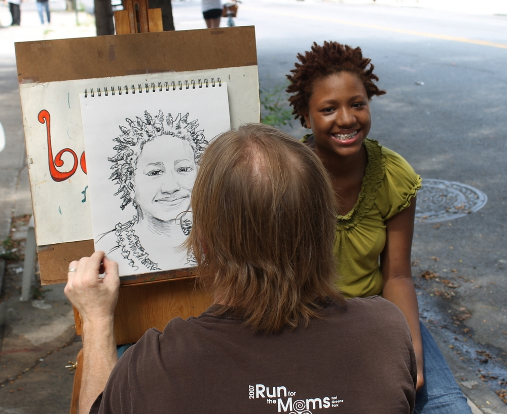 Michael drawing portraits in NYC