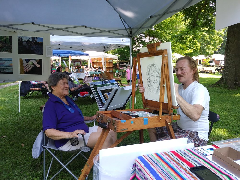 Michael drawing Guerry, a local artist, master storyteller, and delightful woman!