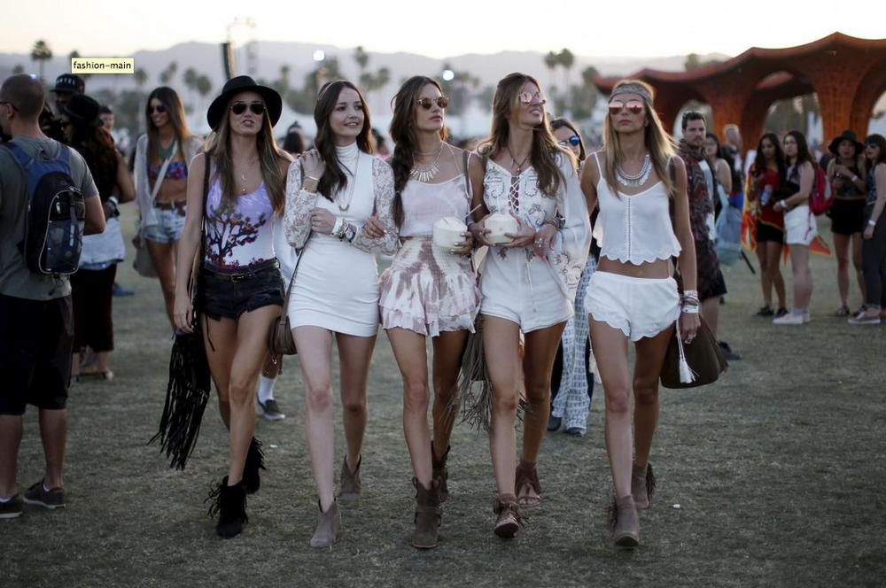 Victoria's Secret model Alessandra Ambrosio of Brazil, center, walks through the Coachella Valley Music and Arts Festival with friends in Indio, California, April 12, 2015
