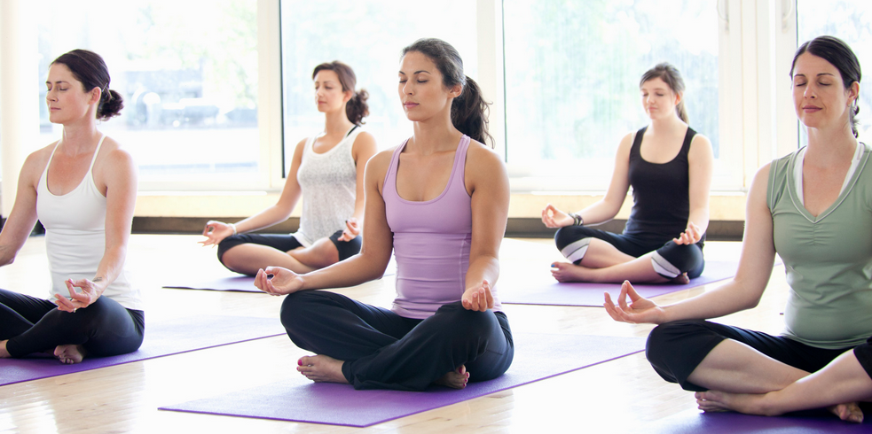 group meditators yoga image.png