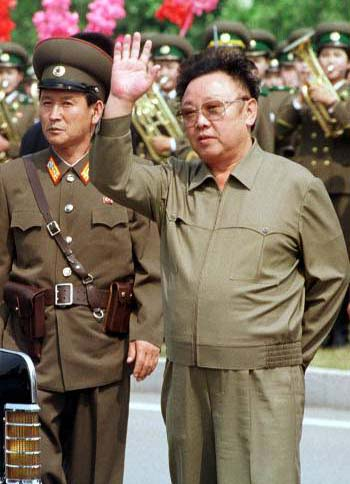 "kim jong il and north korea world cup soccer fact box: May 21 (Reuters) - Factbox on North Korea who are competing in Group G at the 2010 World Cup in South Africa: Colours: All red Nickname: Chollima (Mythical Korean winged horse) Previous World Cup appearances: one Best World Cup performance: Quarter-finals, 1966 Coach: Kim Jong-hun Talking points: North Korea's return to the World Cup finals has rekindled memories of their dream run to the quarter-finals in 1966 in England. However, it is their behaviour off the field that is likely to draw most attention. In a controversial qualifying campaign, the North refused to play the South's anthem or raise the South's flag in Pyongyang, forcing their matches to be moved to Shanghai. They also protested to FIFA that their players were poisoned before a match in Seoul. Tension between the two countries rose this week when South Korea accused the North of torpedoing one of its warships. Player to watch: Jong Tae-se. Dubbed the ""People's Wayne Rooney"" by Asian media, Jong's bustling, all-action style keeps defenders on their toes for 90 minutes. The Japan-based striker is the North's main scoring threat and needs no invitation to have a crack at goal. (Compiled by Peter Rutherford in Singapore; Editing by Robert Woodward; to query or comment on this story email sportsfeedback@thomsonreuters.com) http://g.sports.yahoo.com/soccer/world-cup/news/world-factbox-on-north-korea—fbintl,reu-worldnkoreafactbox_graphic.html"