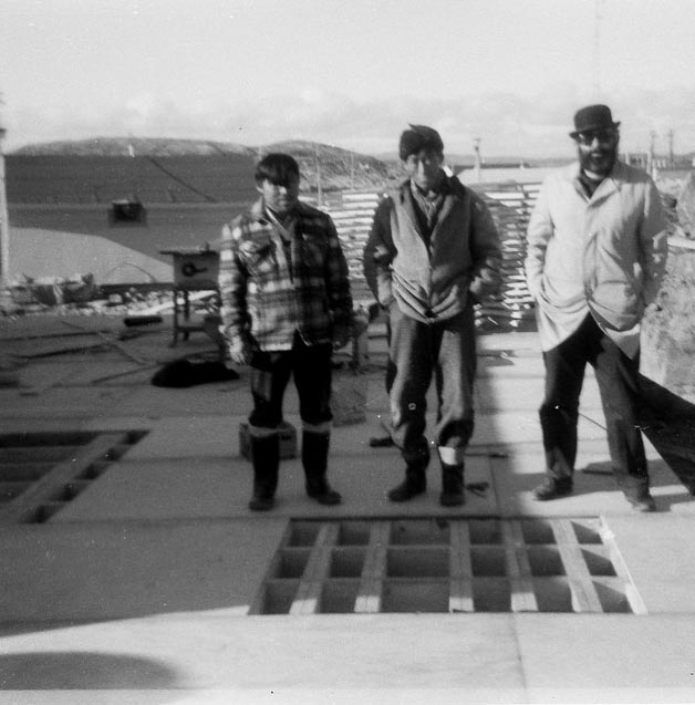 Shuctu, the carpenter, appears in the photo of Wil with the 2 eskimo gentleman standing on the unfinished building.  Shuctu is in the middle.... Wil told me that another eskimo gentleman took this photo.    Photo: HH Johnston Collection, courtesy Sean Johnston.