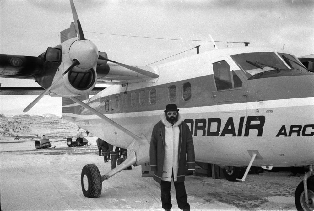 Above: Wil standing next to a Twin Otter. Notice the snowmobiles in the background.  Photo: HH Johnston Collection, courtesy Sean Johnston