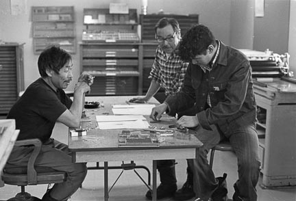 In this picture you can see the Vandercook 4T and the type drawers along the back wall. Left to right: Aggeak Petaulassie, Simionie Koopapik and Pitsiulak Pinguartuk (identified by Qiatsuq Niviaqsie). Photo: Tessa MacIntosh