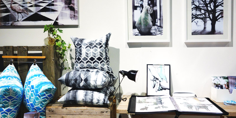 Camilla Edfors cushion covers along with some of her art prints and posters.  Top: Designer Camilla Edfors.