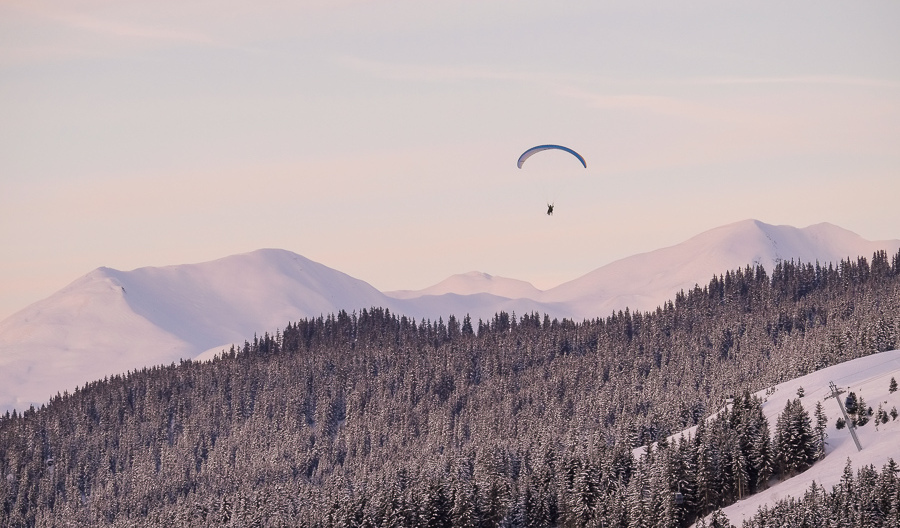 Lone paraglider pink sky.jpg