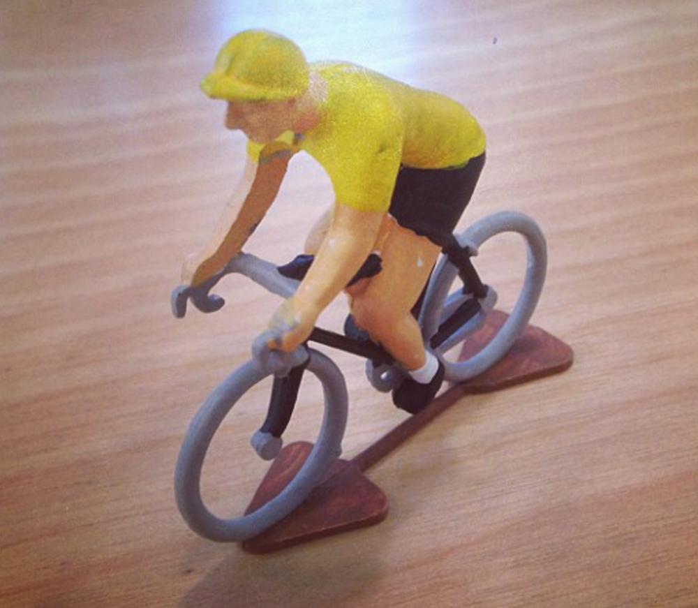 DYLAN:  I always bring this little cycling figurine from the 30s to my desks wherever they are. I guess it helps me define the space as mine. It's also a nice reminder that I work better when I'm able to mix in some time for bike rides.
