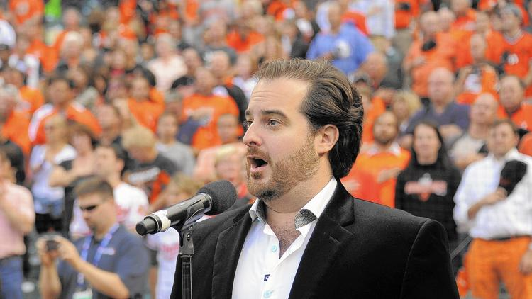 Rolando Sanz performs the National Anthem prior to Game 1 of the ALDS. (Karl Merton Ferron, Baltimore Sun)