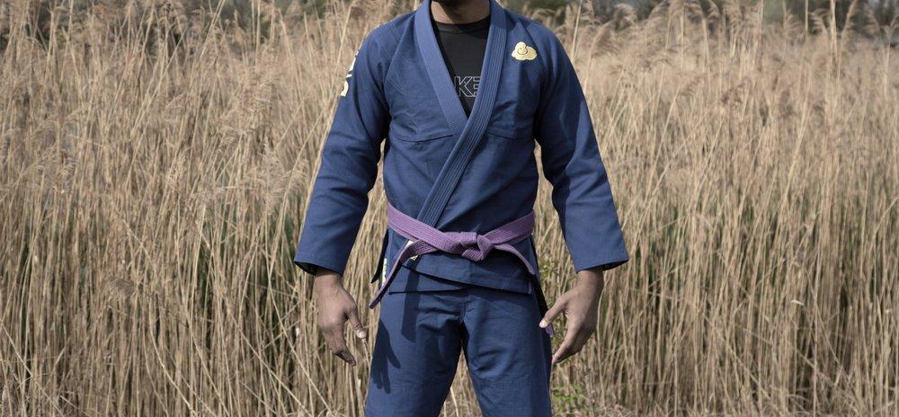 Temple Gi Blue and Temple Rashguard underneath Model: Bryan Thompson IBJJF World Champion