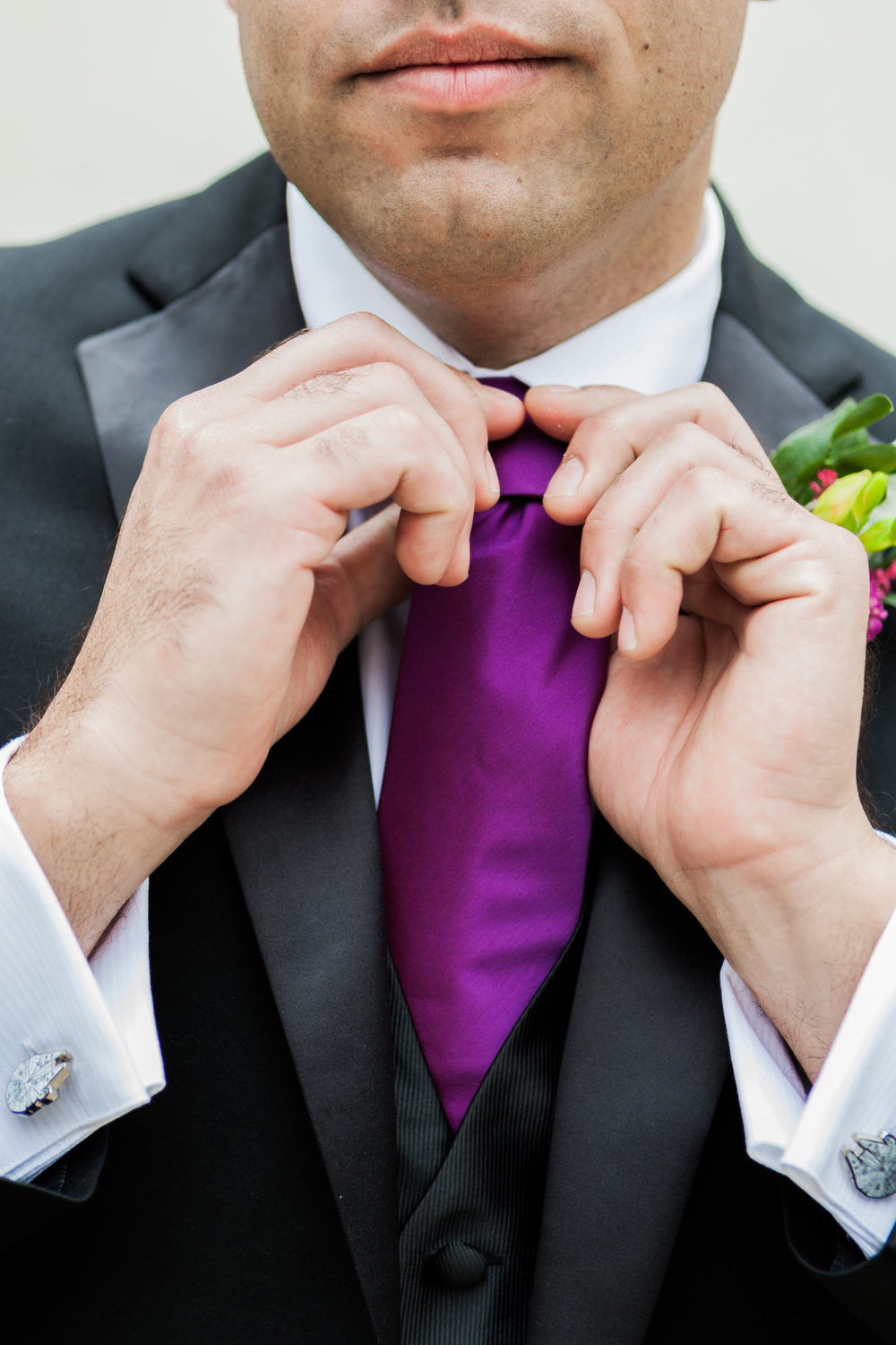 purple and black groom attire