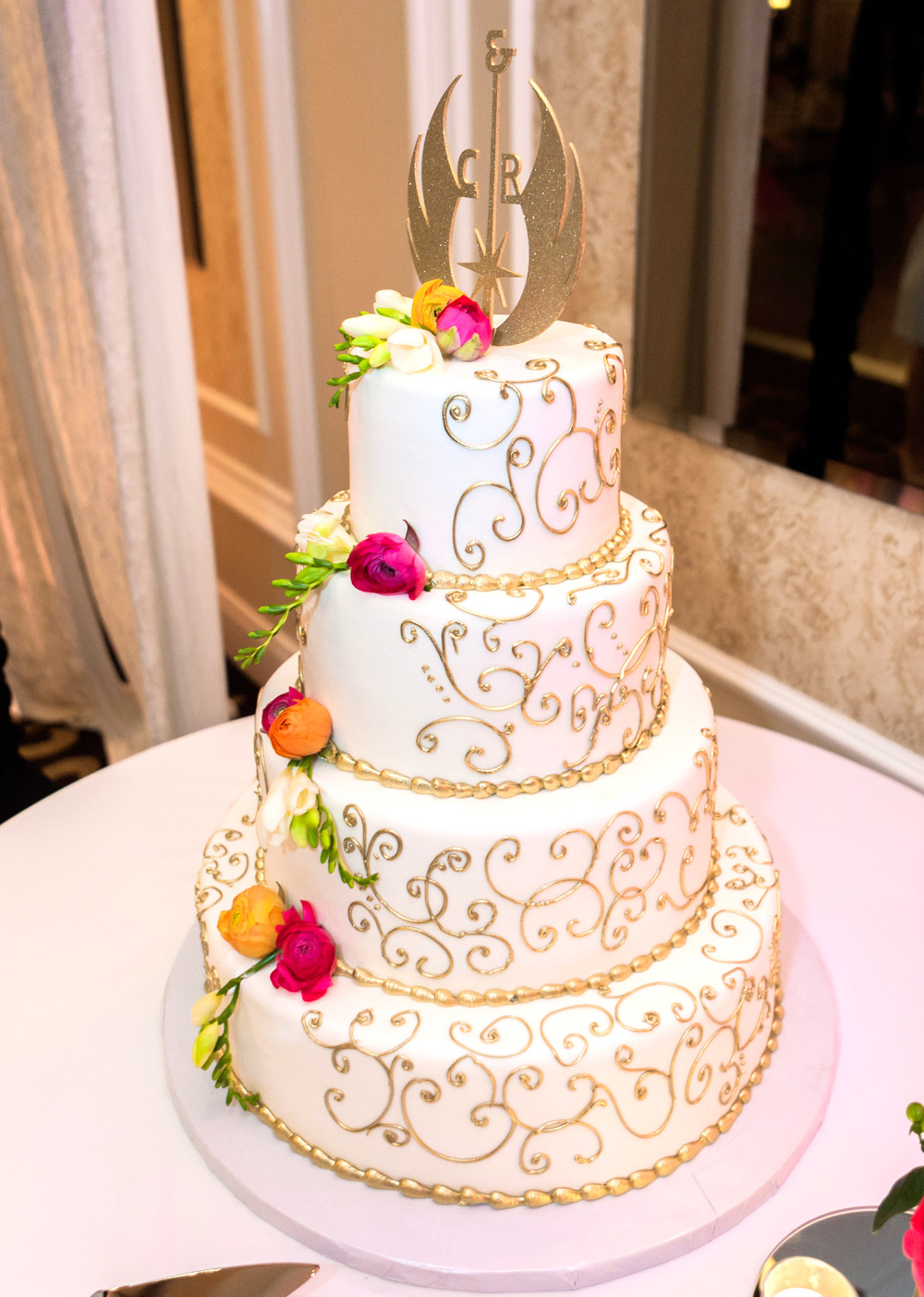 gold and white musical themed wedding cake