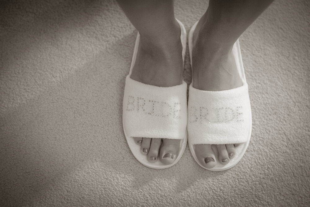 bride getting ready slippers // white wedding shoes // Rocksalt Photography