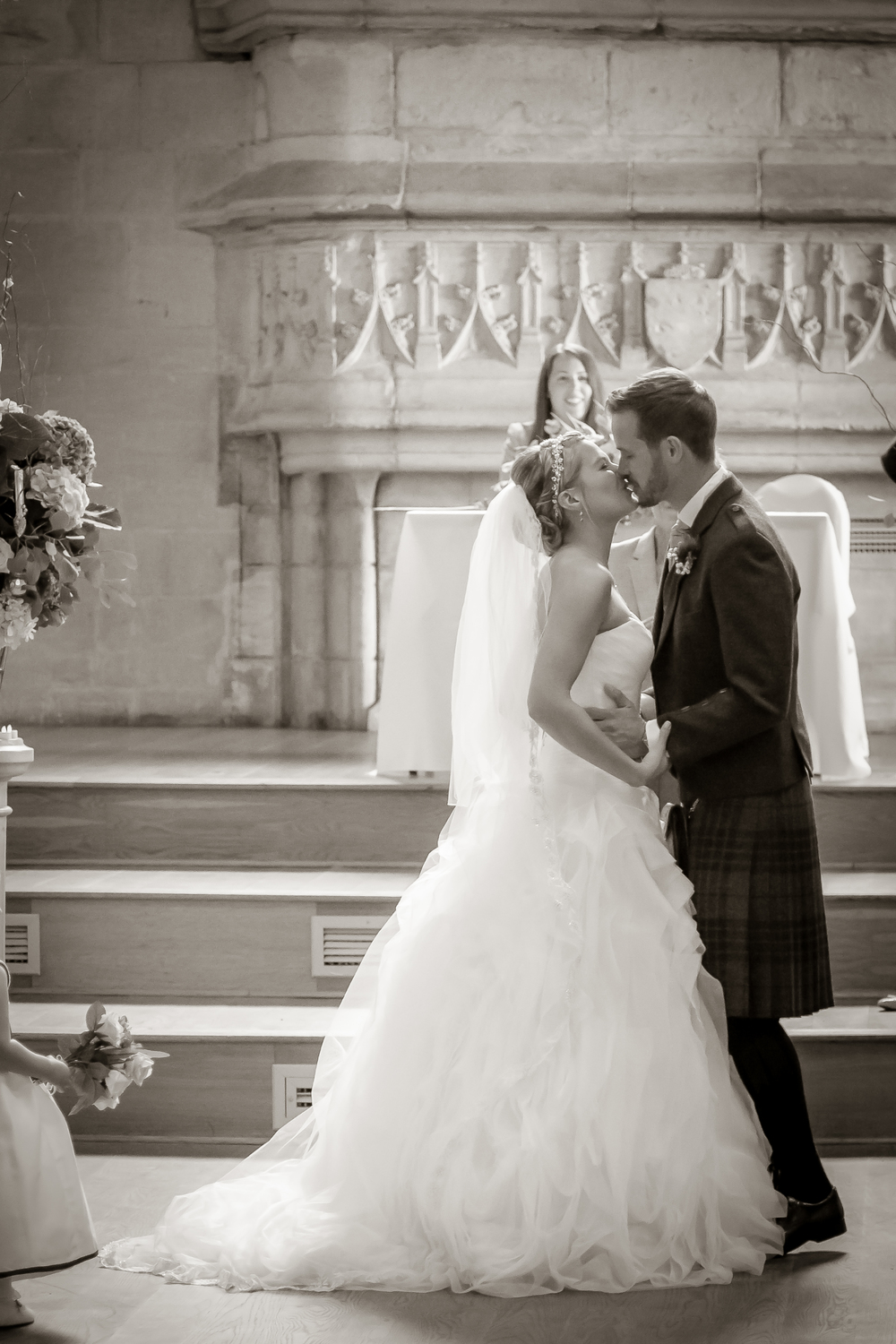 bride and groom first kiss //  castle wedding venue Wales UK // Rocksalt Photography