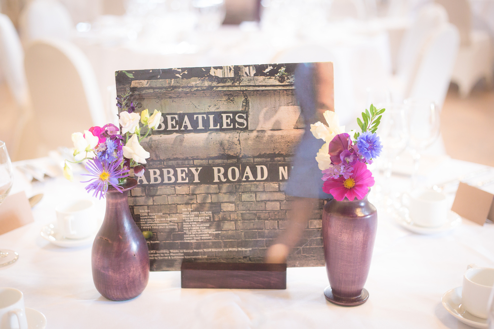 creative wedding table names //  castle wedding venue Wales UK // Rocksalt Photography