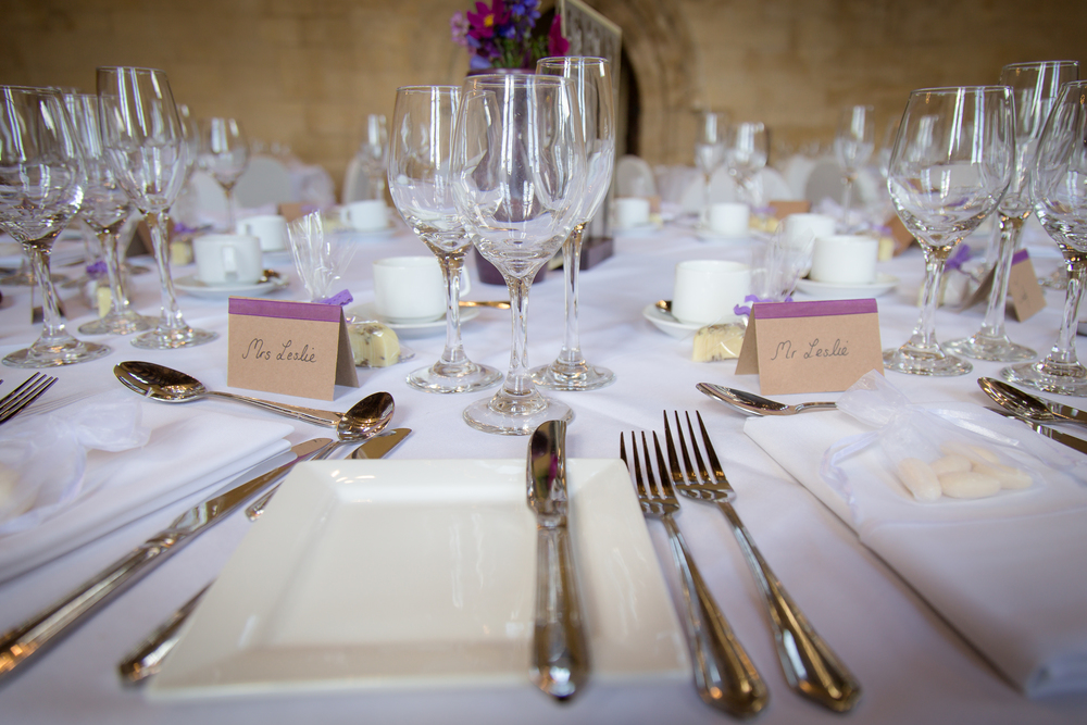 purple and white wedding place setting //  castle wedding venue Wales UK // Rocksalt Photography