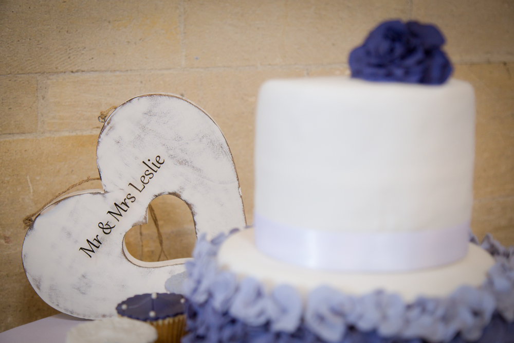 white and purple simple wedding cake // //  castle wedding venue Wales UK // Rocksalt Photography