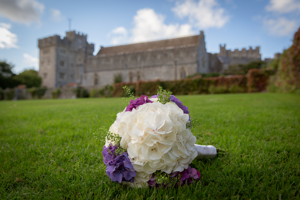 purple and white wedding bouquet //  castle wedding venue Wales UK // Rocksalt Photography