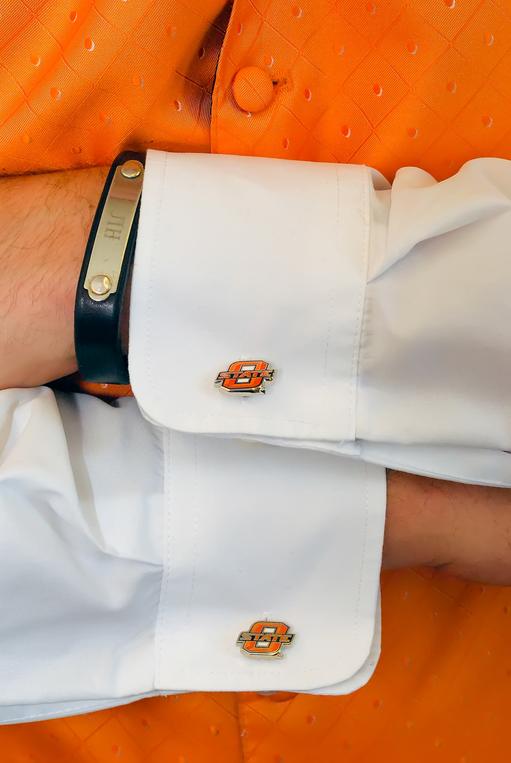 guthrie oklahoma wedding venue - dominion house orange groom cufflinks