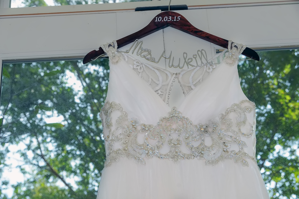 guthrie oklahoma wedding venue - dominion house - bride wedding dress hanger