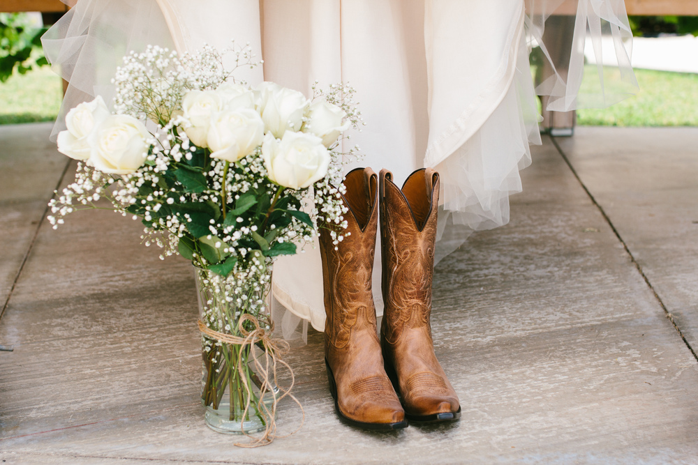 cowgirl bridal boots - rustic intimate oklahoma wedding at Darlington Chapel