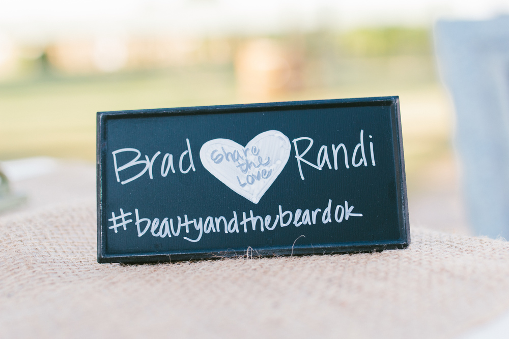 rustic wedding hashtag instagram sign - rustic intimate oklahoma wedding at Darlington Chapel