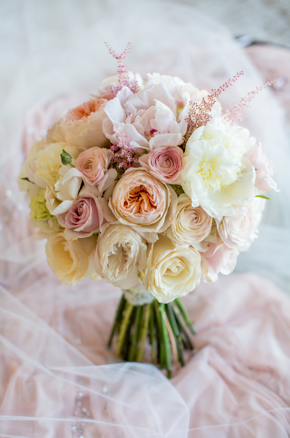 blush and white rose and peony wedding bouquet - - A Diamond Hotel Penthouse Wedding by Katelyn Owens Photography