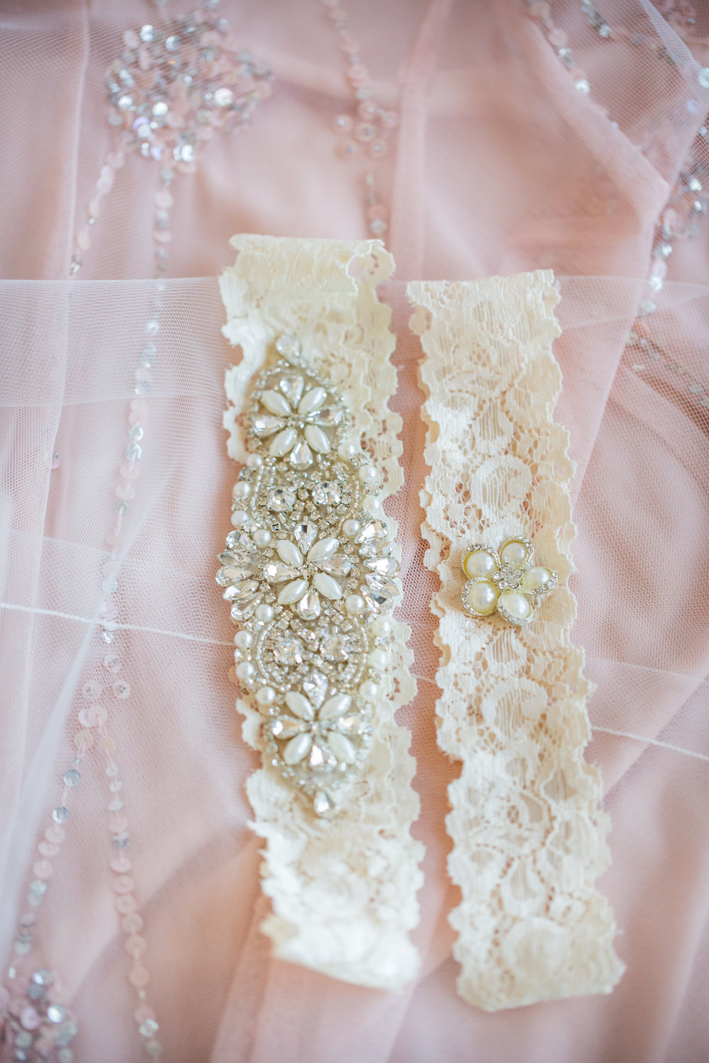 white lace and beaded garter - - A Diamond Hotel Penthouse Wedding by Katelyn Owens Photography