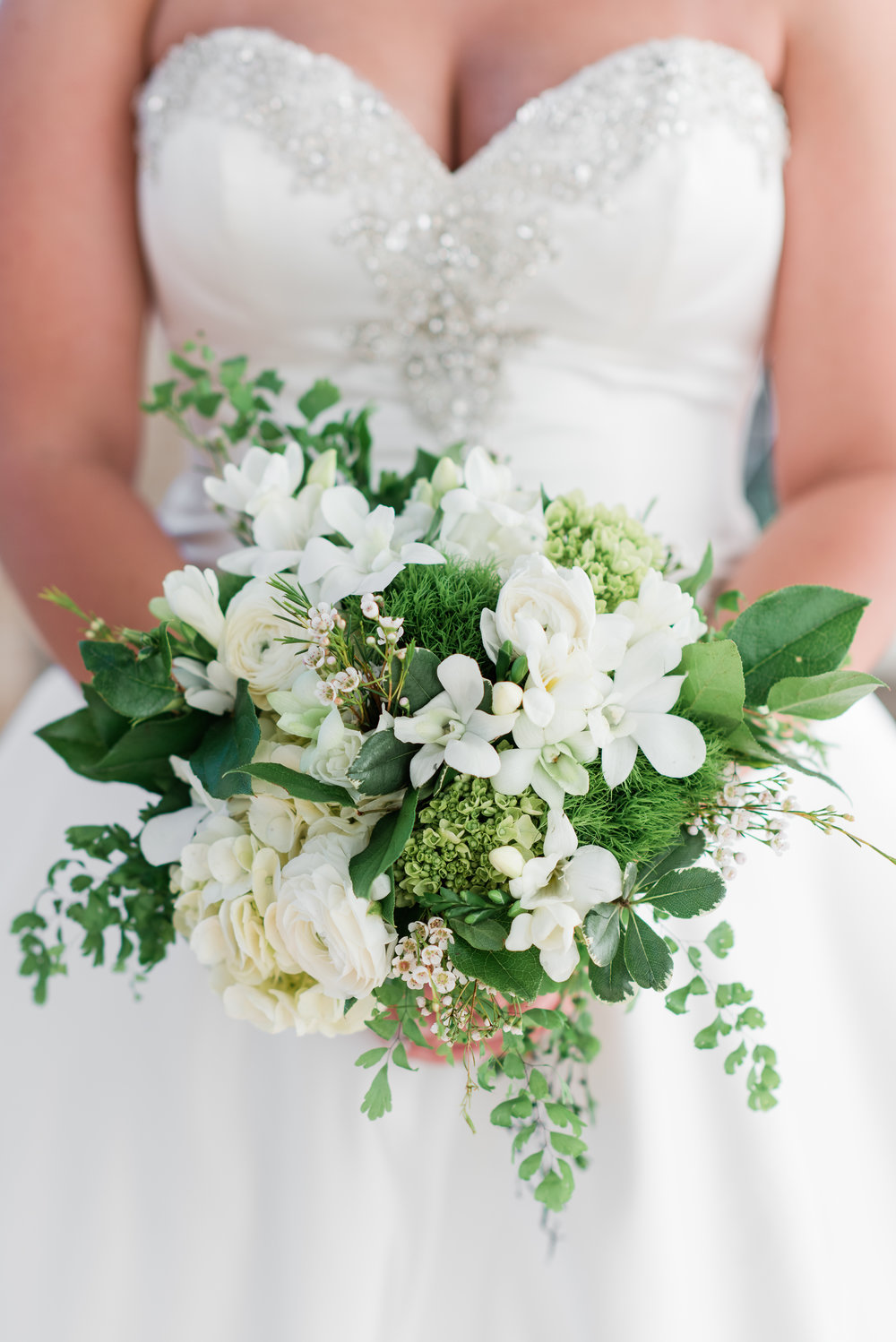 White bridal bouquet with lots of greenery - A Black Tie, South Carolina Commerce Club Wedding