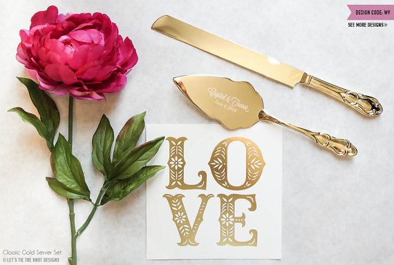 Gold Engraved Wedding Cake and Knife Servers