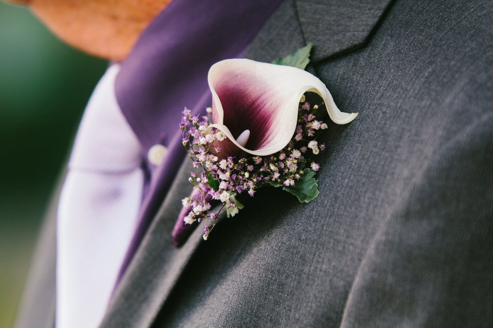 Purple Lily Grooms Boutonniere = Gorgeous Black and White Bridal Portraits - A Simple Purple + White Wedding by From Britt's Eye View