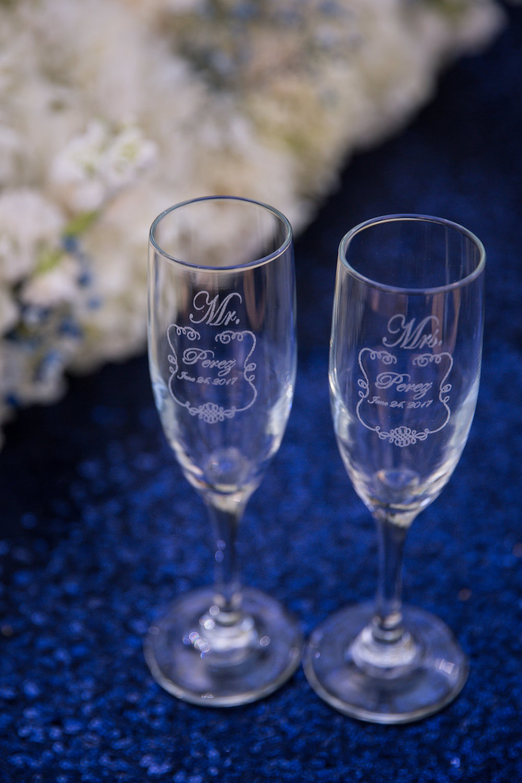 Engraved Bride and Groom Champagne Flutes - A Blue + Gold Rancho El Toro Courtyard Wedding - Oana Foto