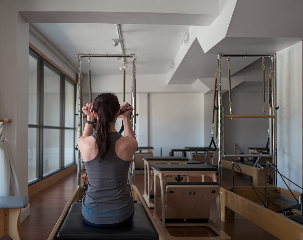 Grace Nicklos works on the reformer. Photo by Troy McCarty.
