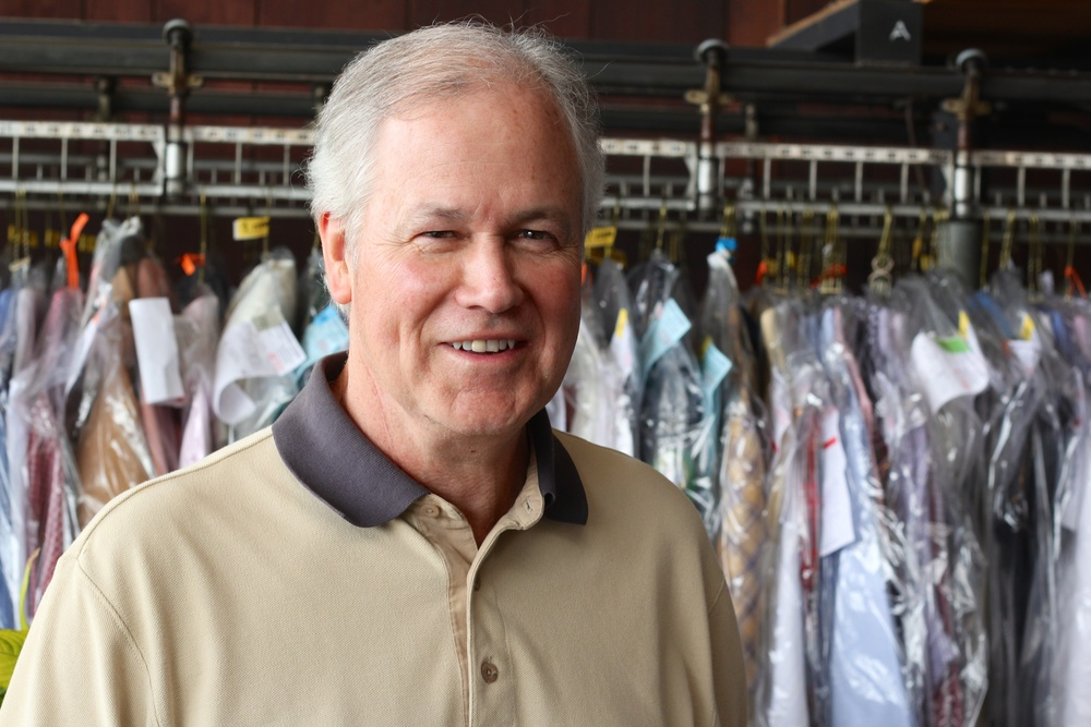 Brian in front of a conveyor clothing rack.jpg