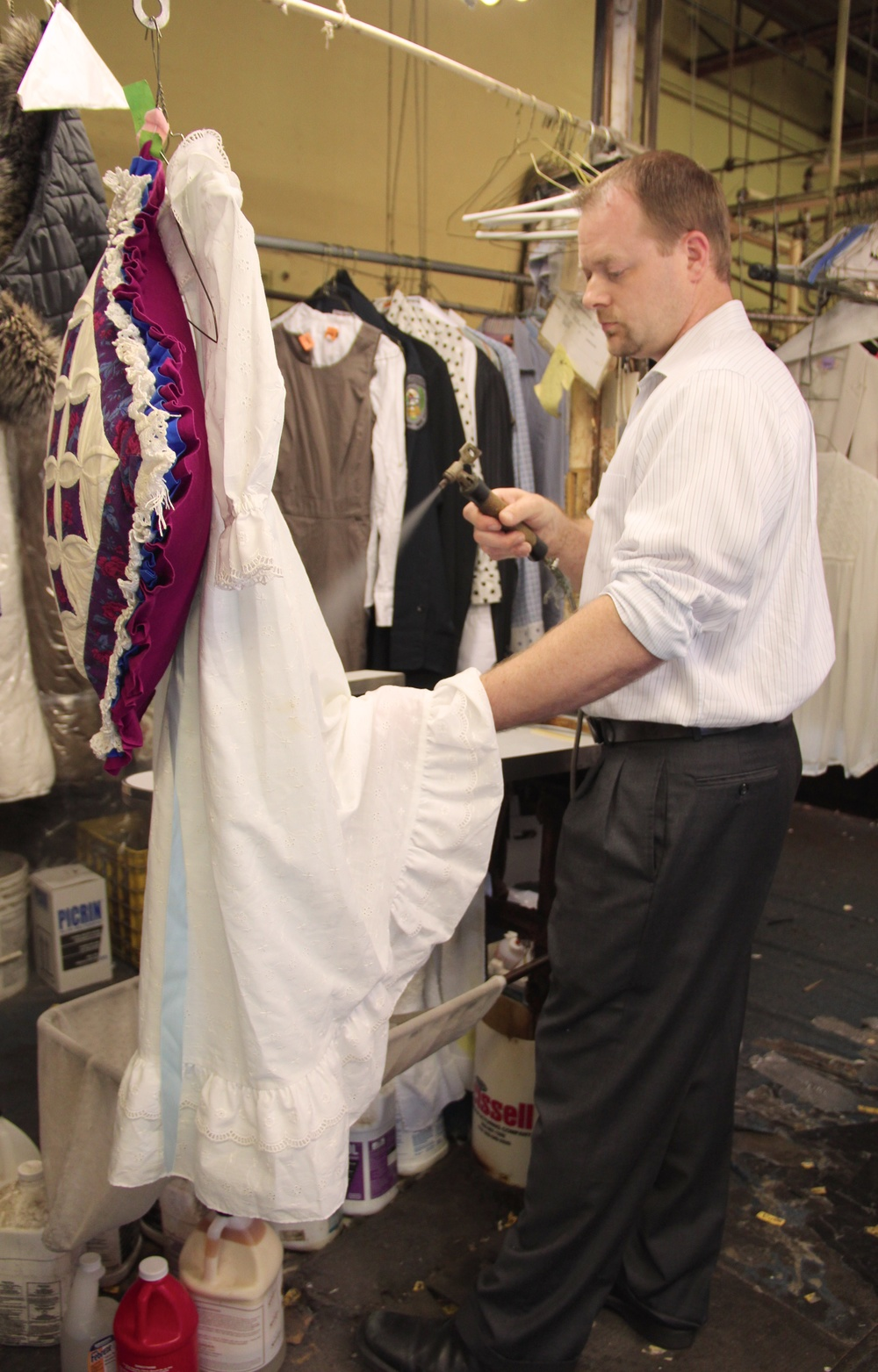 Derek removing the spot out of a dress.jpg