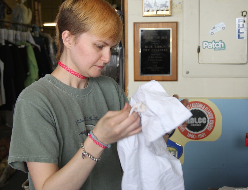 Jodi examining a shirt for content - care label.jpg