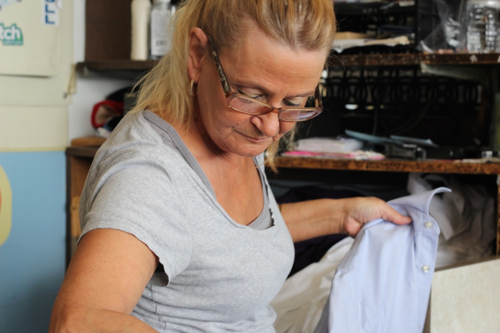 Meredith tagging and checking in a shirt.jpg