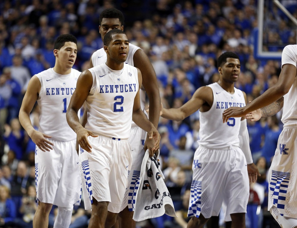 Jan 20, 2015; Lexington, KY, USA; Kentucky Wildcats guard Aaron Harrison (2) celebrates with teammates during the game against the Vanderbilt Commodores in the second half at Rupp Arena. The Kentucky Wildcats defeated the Vanderbilt Commodores 65-57. Mandatory Credit: Mark Zerof-USA TODAY Sports