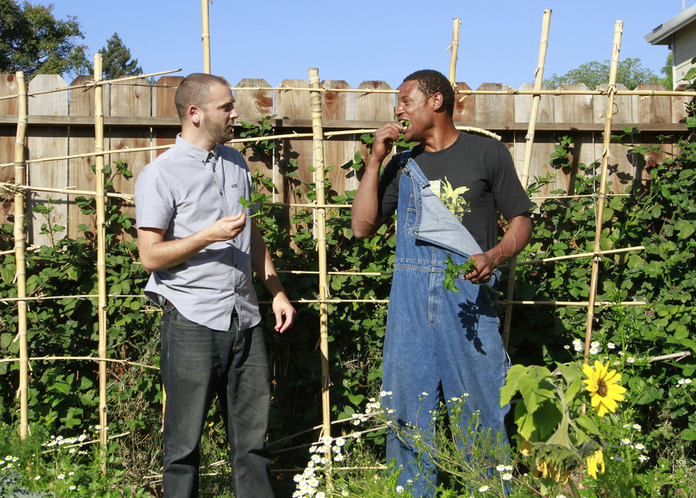 Josh Healey and Region Lewis enjoying the bounty at Full Harvest Farm.