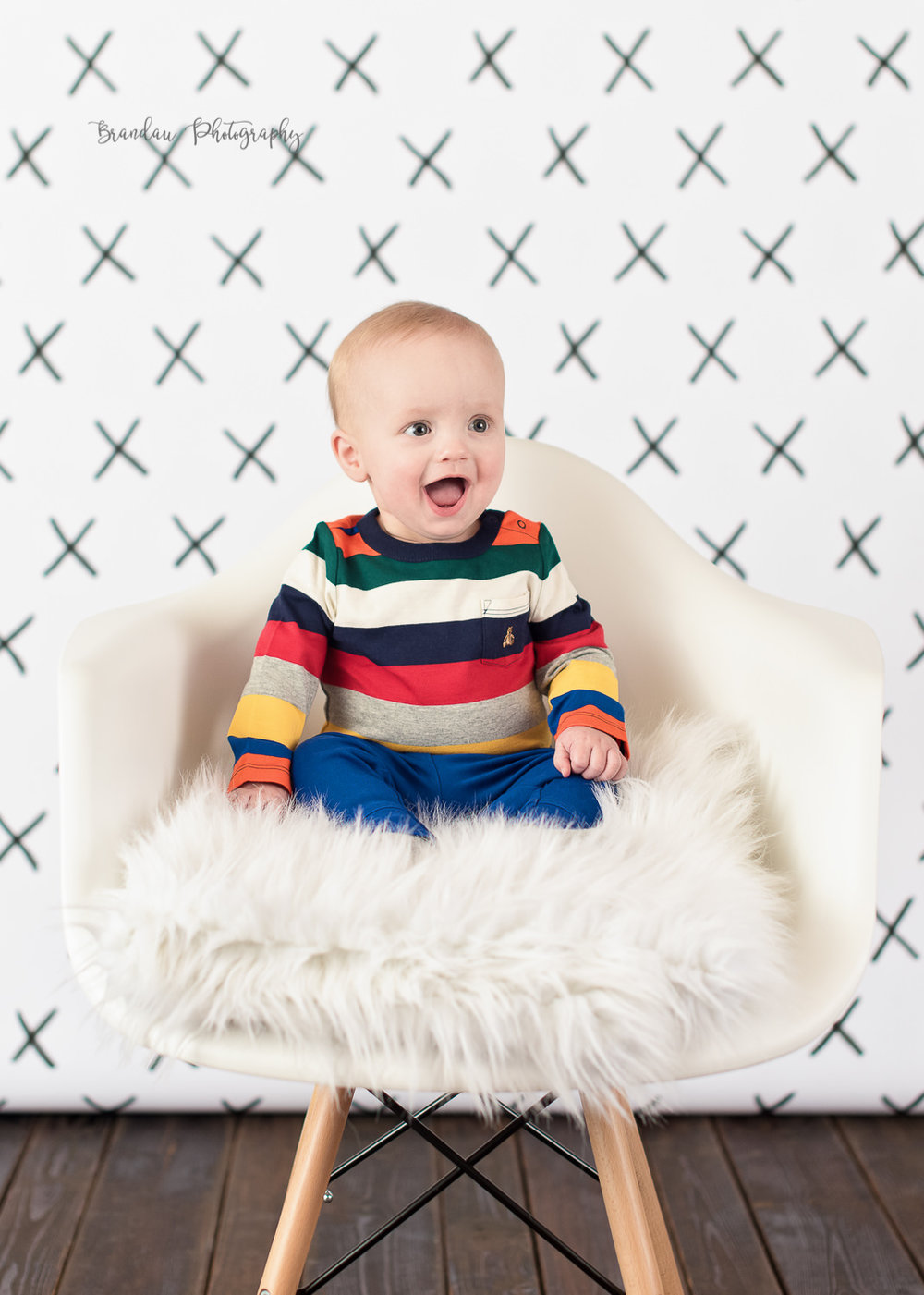 Boy laughing chair_ Brandau Photography.jpg