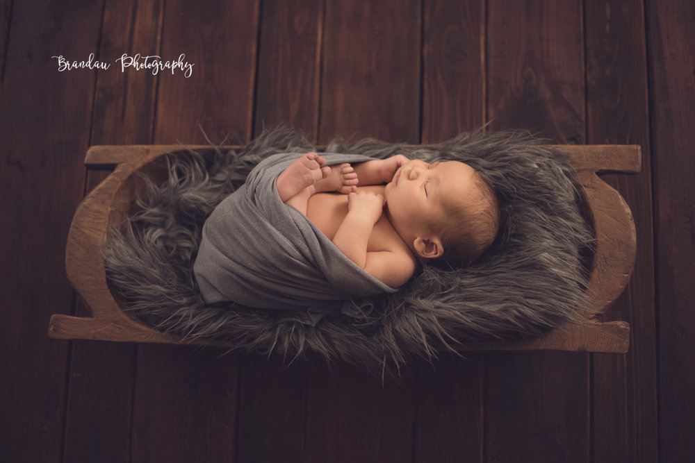 newborn sleeping in bread bowl_Brandau Photography.jpg