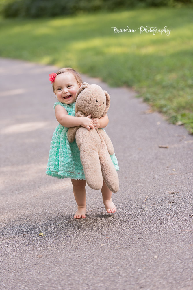 Brandau Photography - Girl smiling with bear.jpg