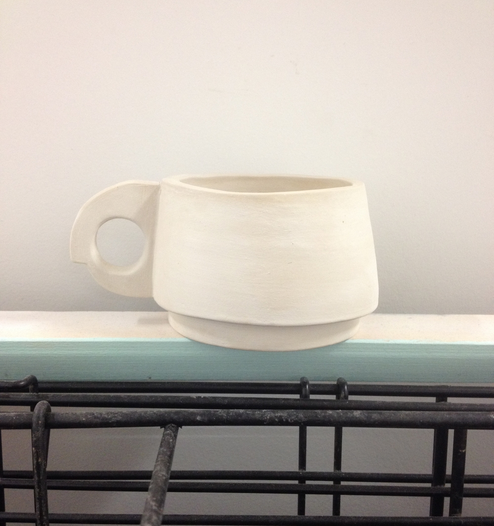 Un fired (green) porcelain and terracotta mugs
