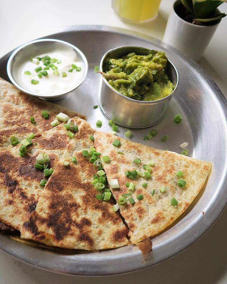 The simplest dish on the menu: cheese quesadillas, some crema, and a side of guac.